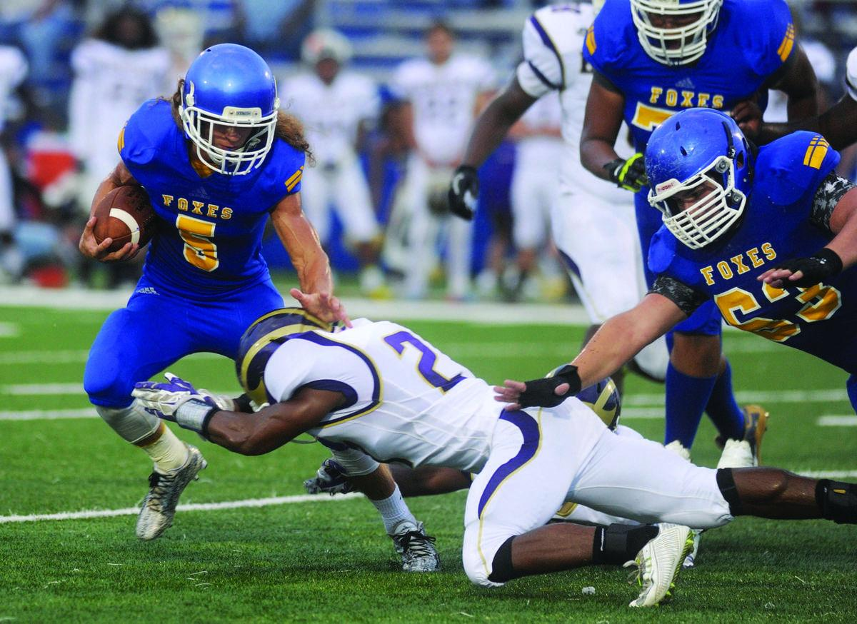 High school football: Trojans' armor repels Foxes
