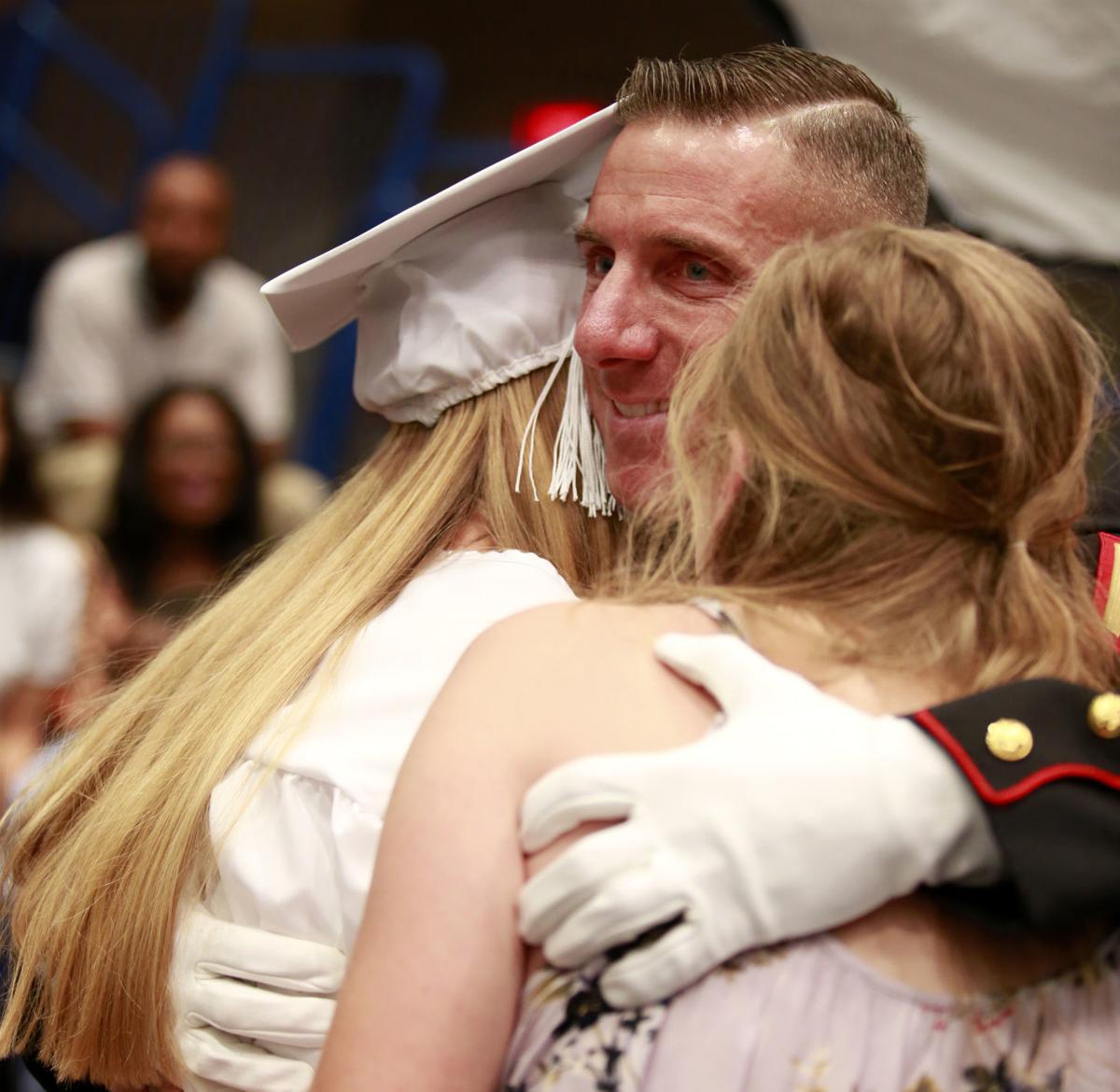 Marine dad surprises daughter at graduation