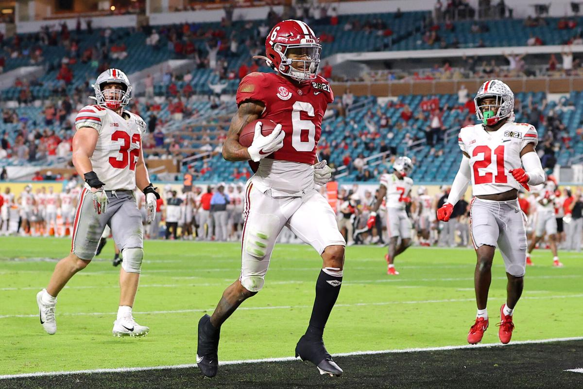 DeVonta Smith #6 of the Alabama Crimson Tide rushes for a 42 yard touchdown during the second quarter of the College Football Playoff National Championship game against the Ohio State Buckeyes at Hard Rock Stadium on Jan. 11, 2021 in Miami Gardens, Florida.