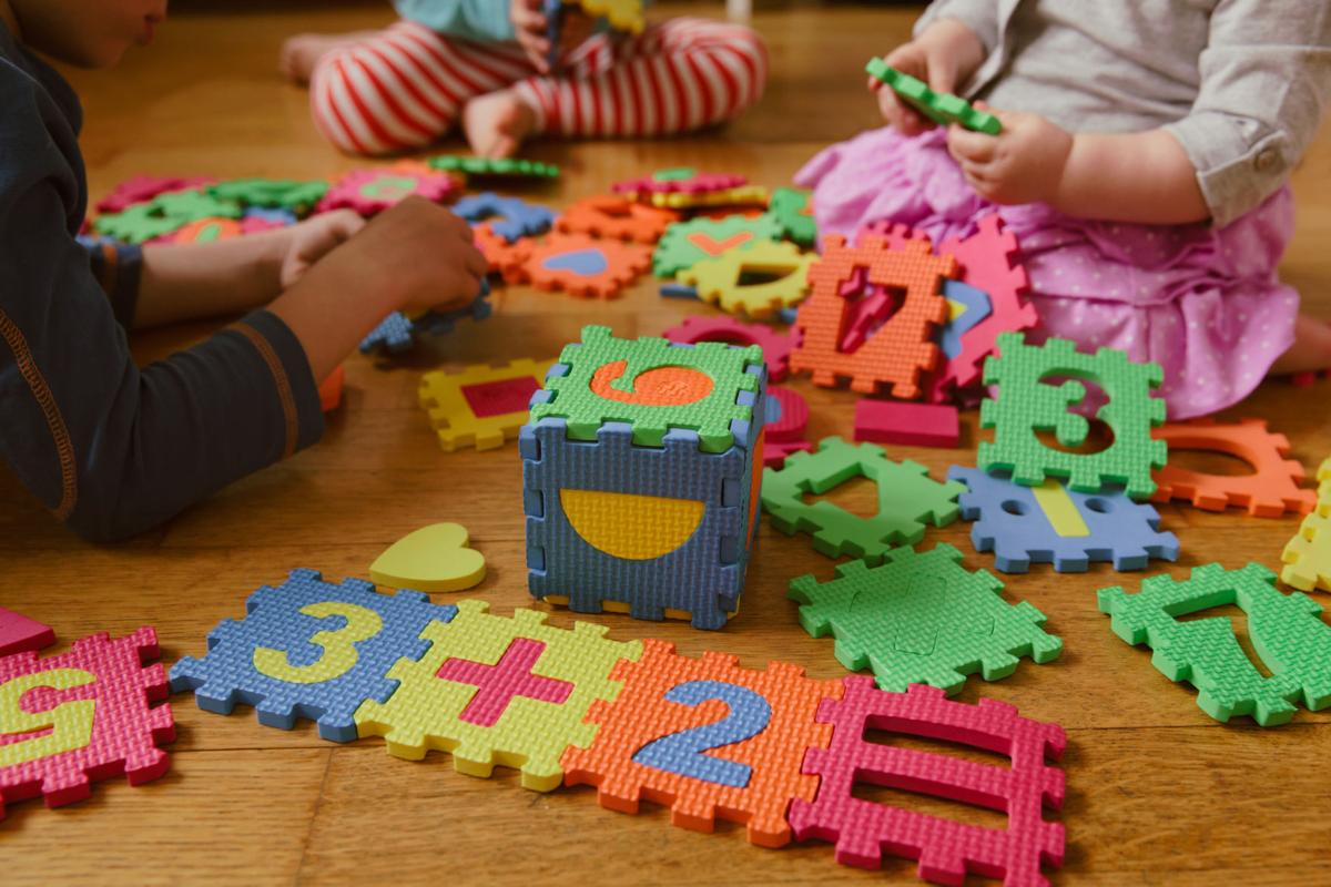 kids playing with puzzle, education concept