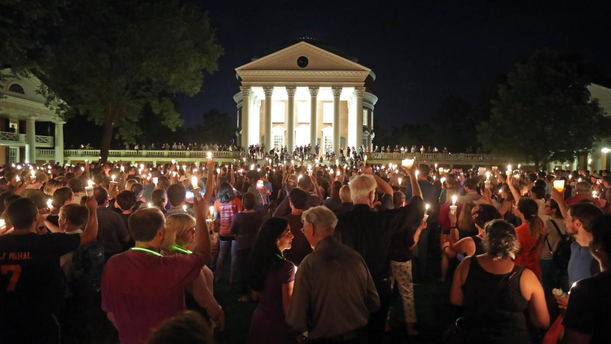 Carrying candles and singing, thousands gather to reclaim the Rotunda