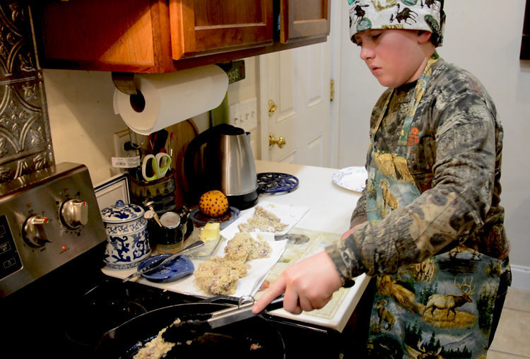 Colton Josselyn cooking Jim Crumley squirrel recipe - Outdoors Rambler
