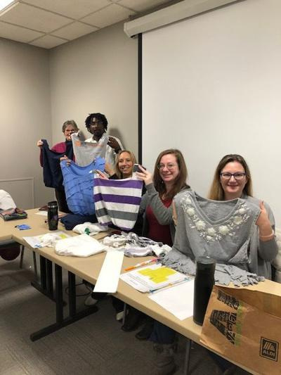 EARTH FRIENDLY: Volunteers transform T-shirts into tote bags