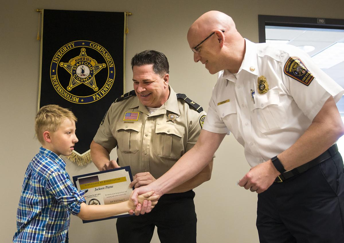 Stafford fourth-grader honored for saving mother, brother in