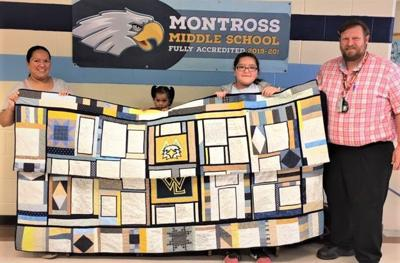 Students' poetry quilt raises funds for classroom