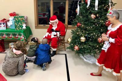 Santa and Mrs. Claus delight Orange County foster children.