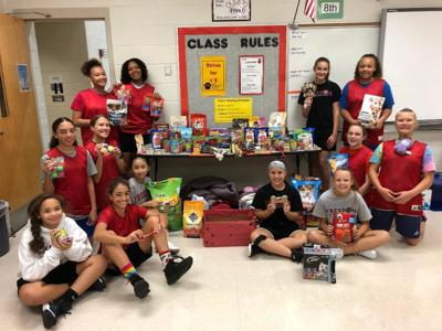 SCORE: Lady Tigers collect donations for SPCA
