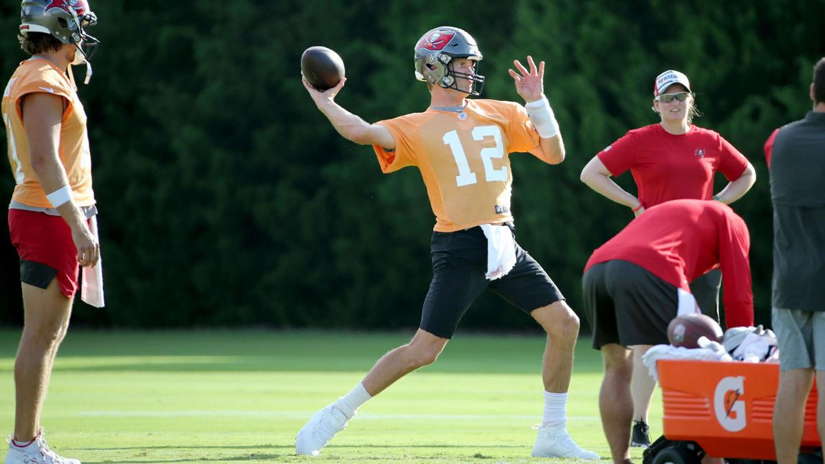 Tom Brady loads up a pass during Bucs training camp on Monday, August 2, 2021.