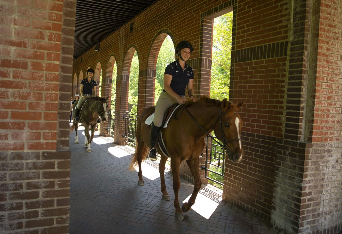 Seniors Trot Across Campus On Horseback To Salute Four