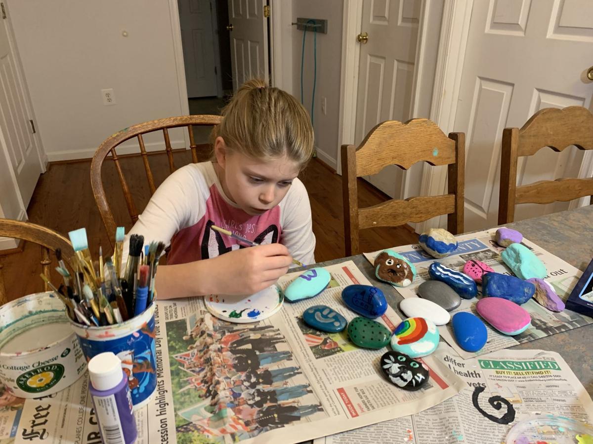 Adalena DeSimini paints rocks for her ROCK HOPE project