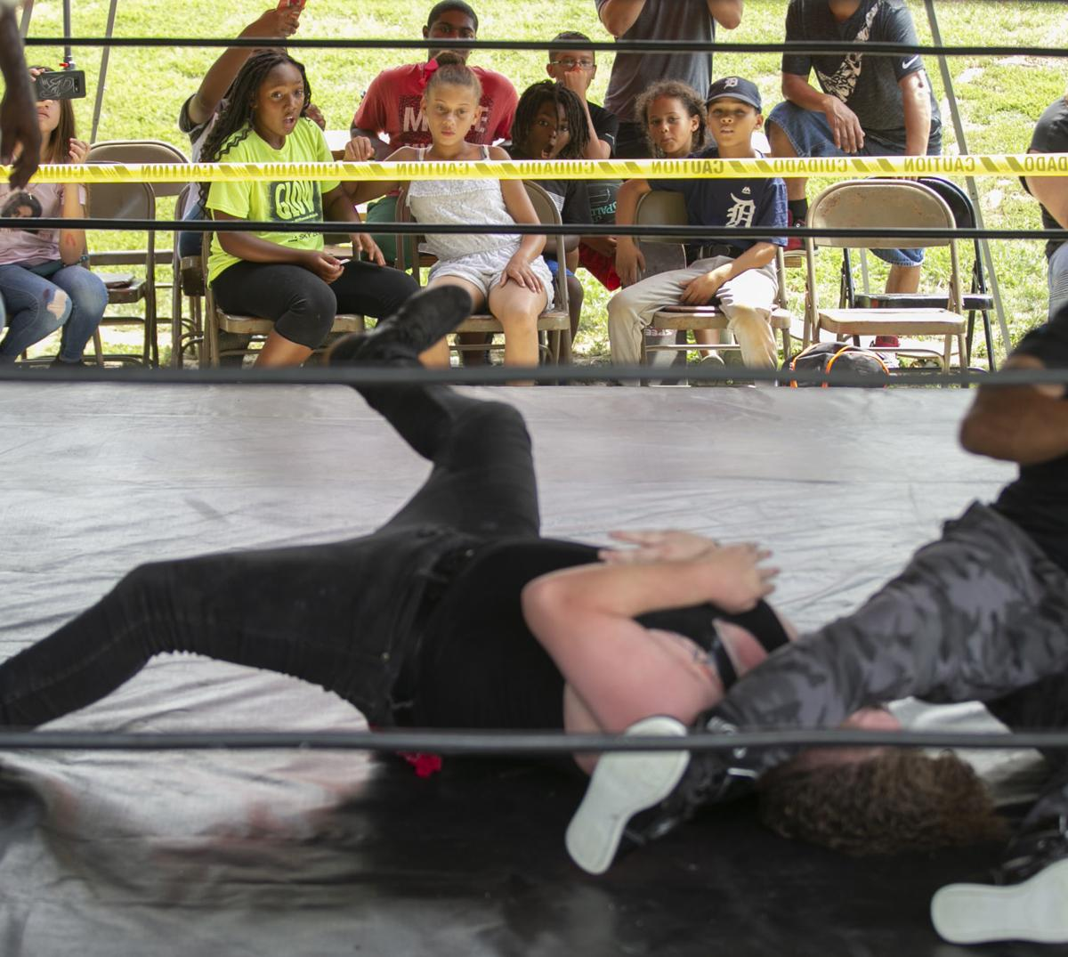 Wrestlers Trade Punches, Collect School Supplies