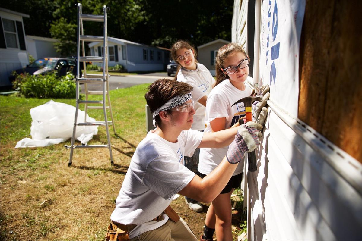 Teenagers spend part of summer repairing homes