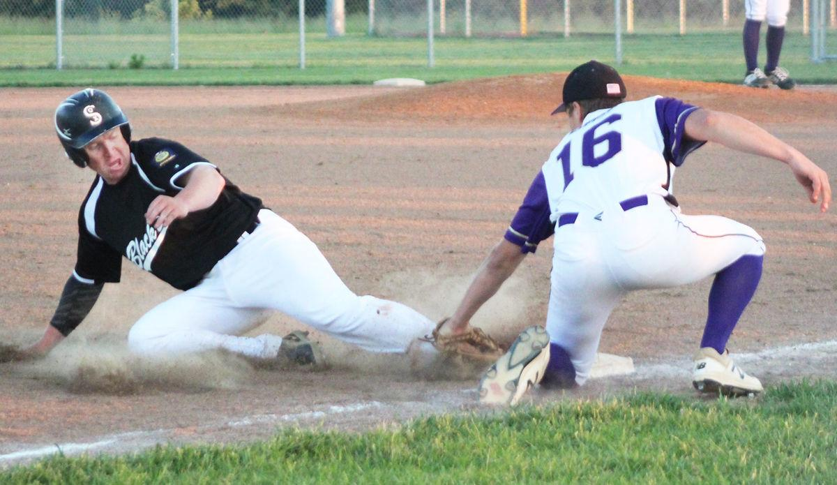Jaren Powell tags out runner at third base
