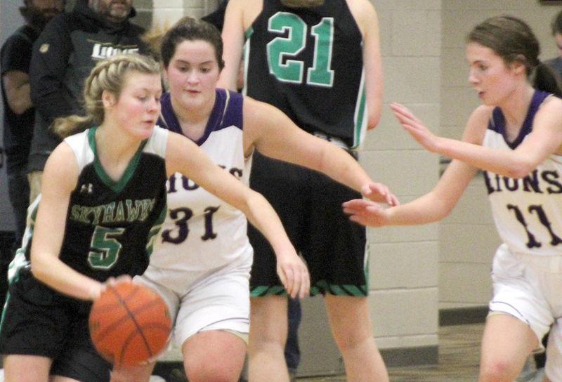 Lauryn Kalkowski and Avery Heard on defense