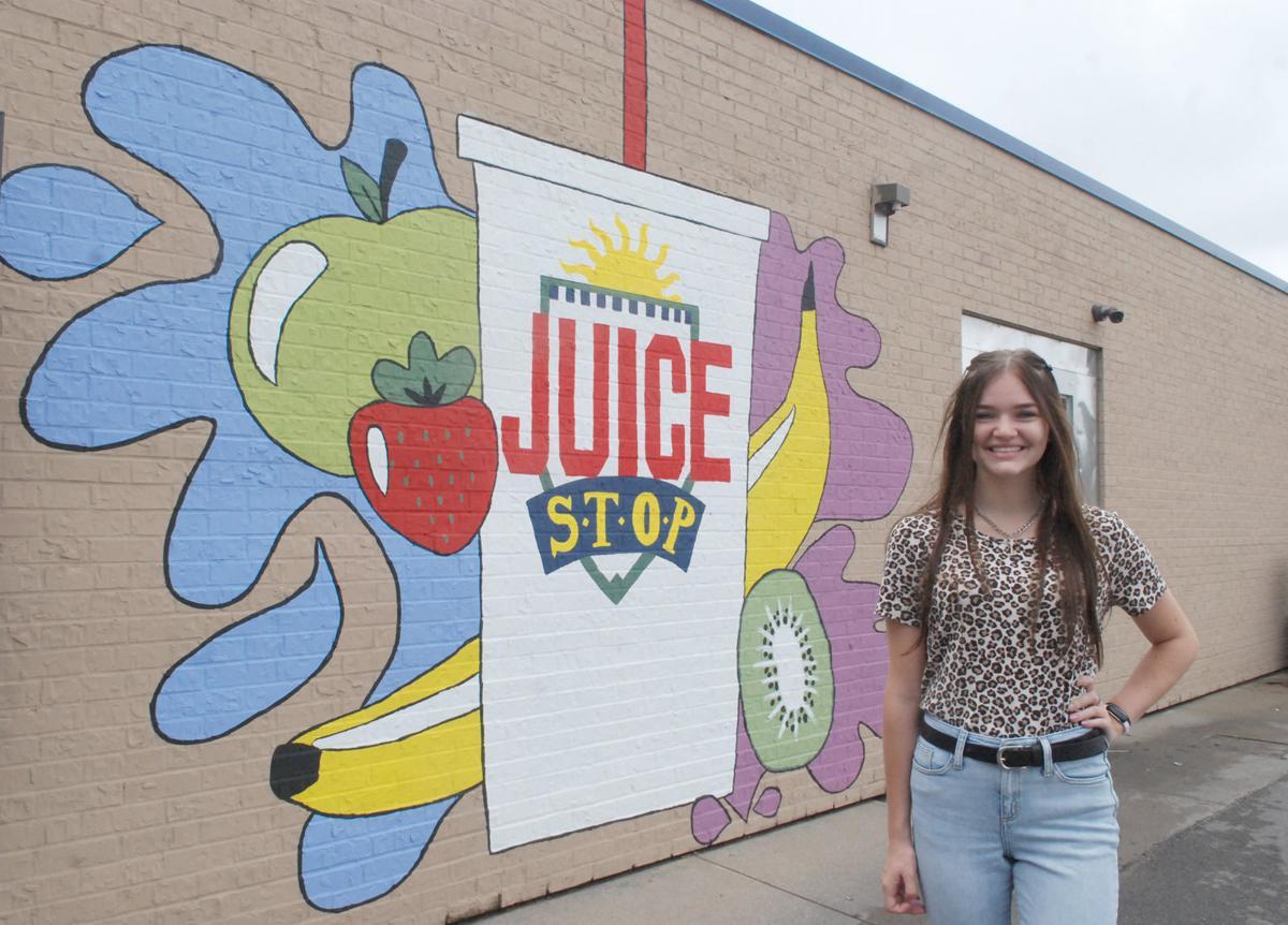Juice Stop mural girl