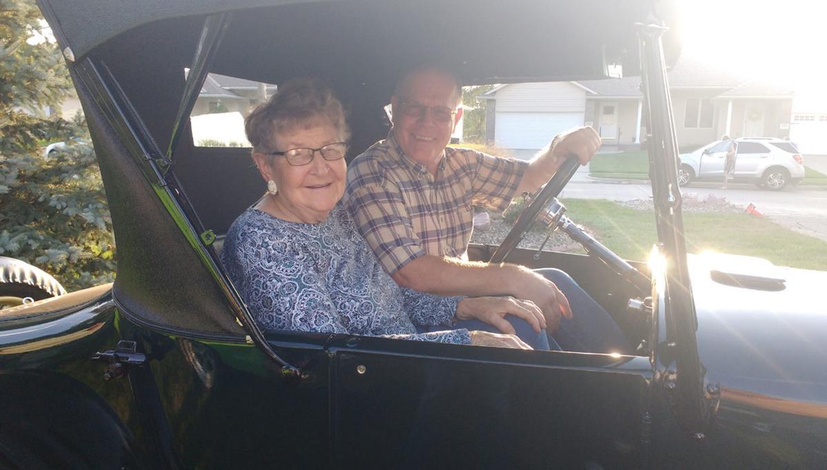 Bob Buer and passenger in Model T car