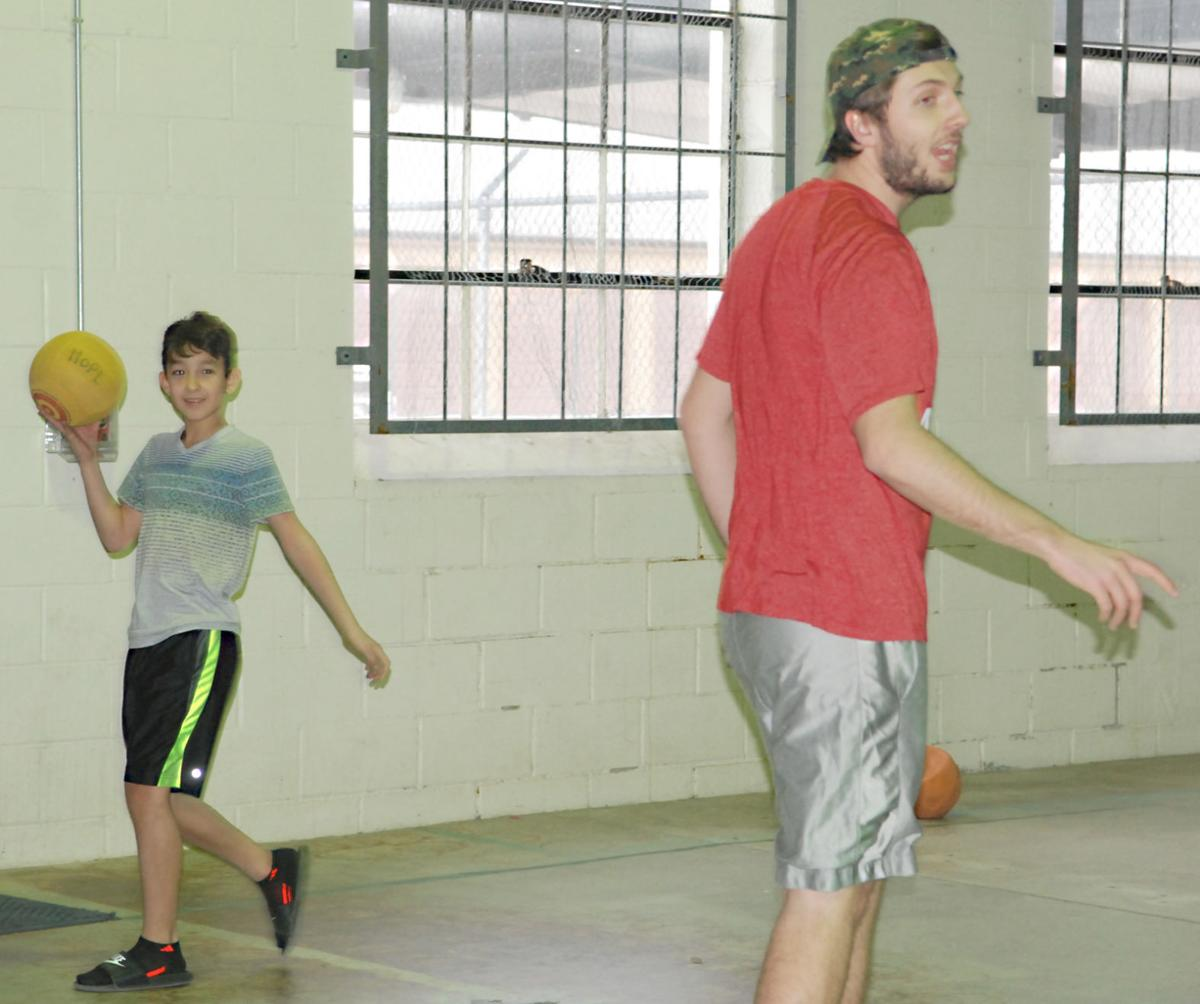 Renter and boy in dodge ball game