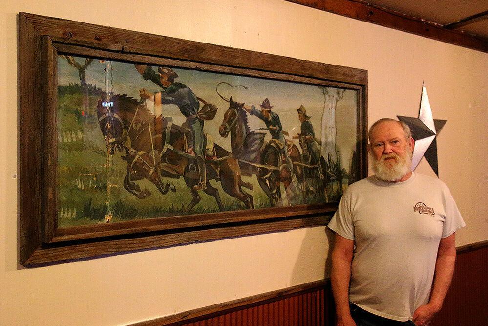 Minatare man discovers art behind restaurant wall