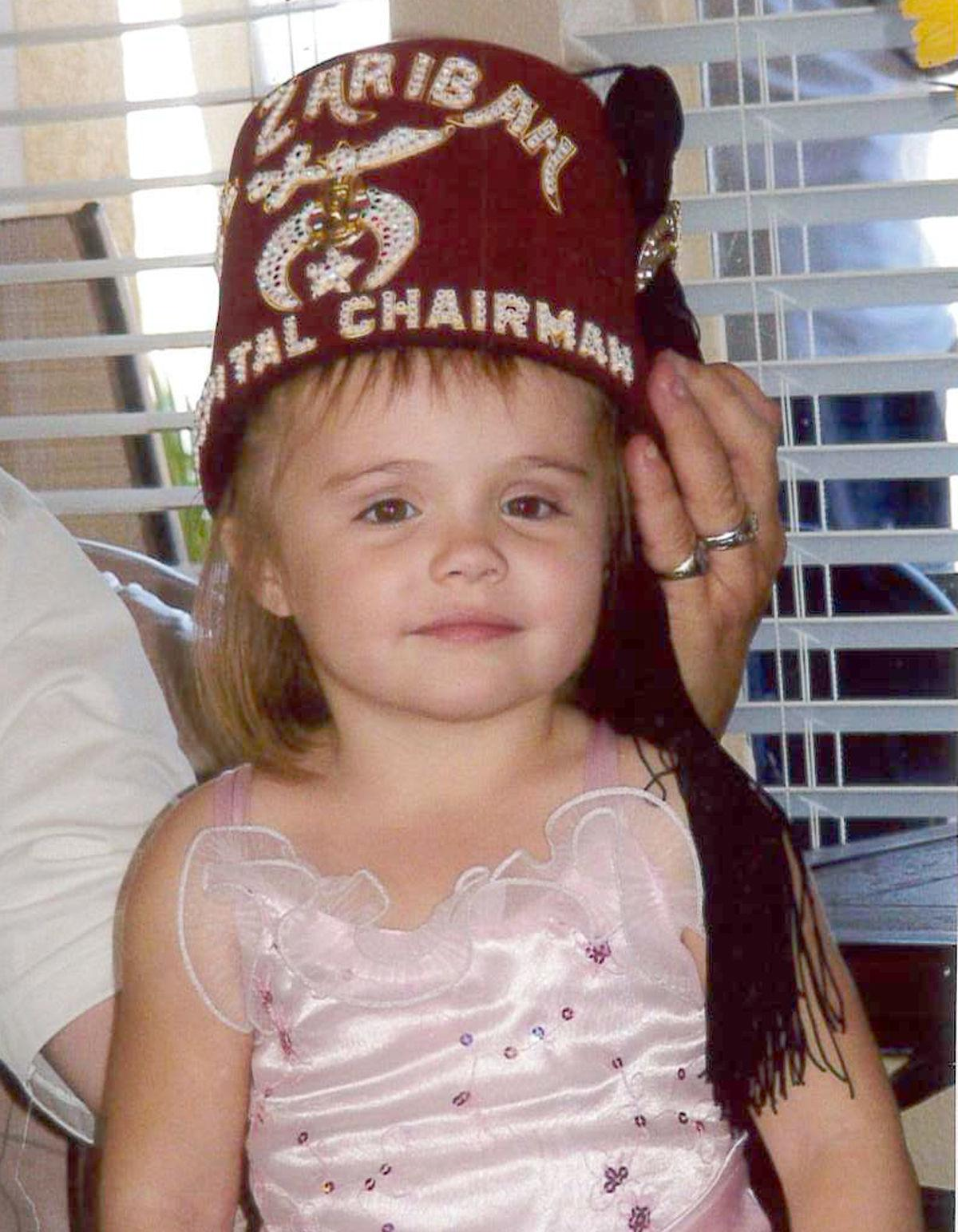 Little girl in Shriner's hat