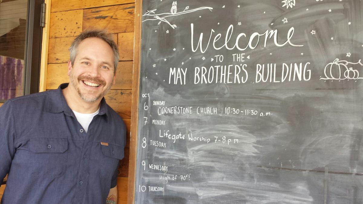 Pastor near coffeehouse chalk board