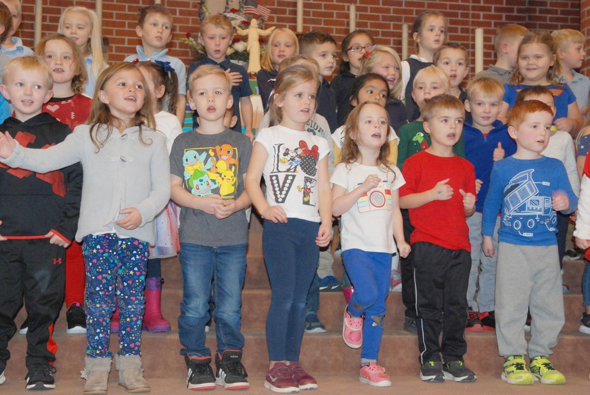 Trinity children singing in program