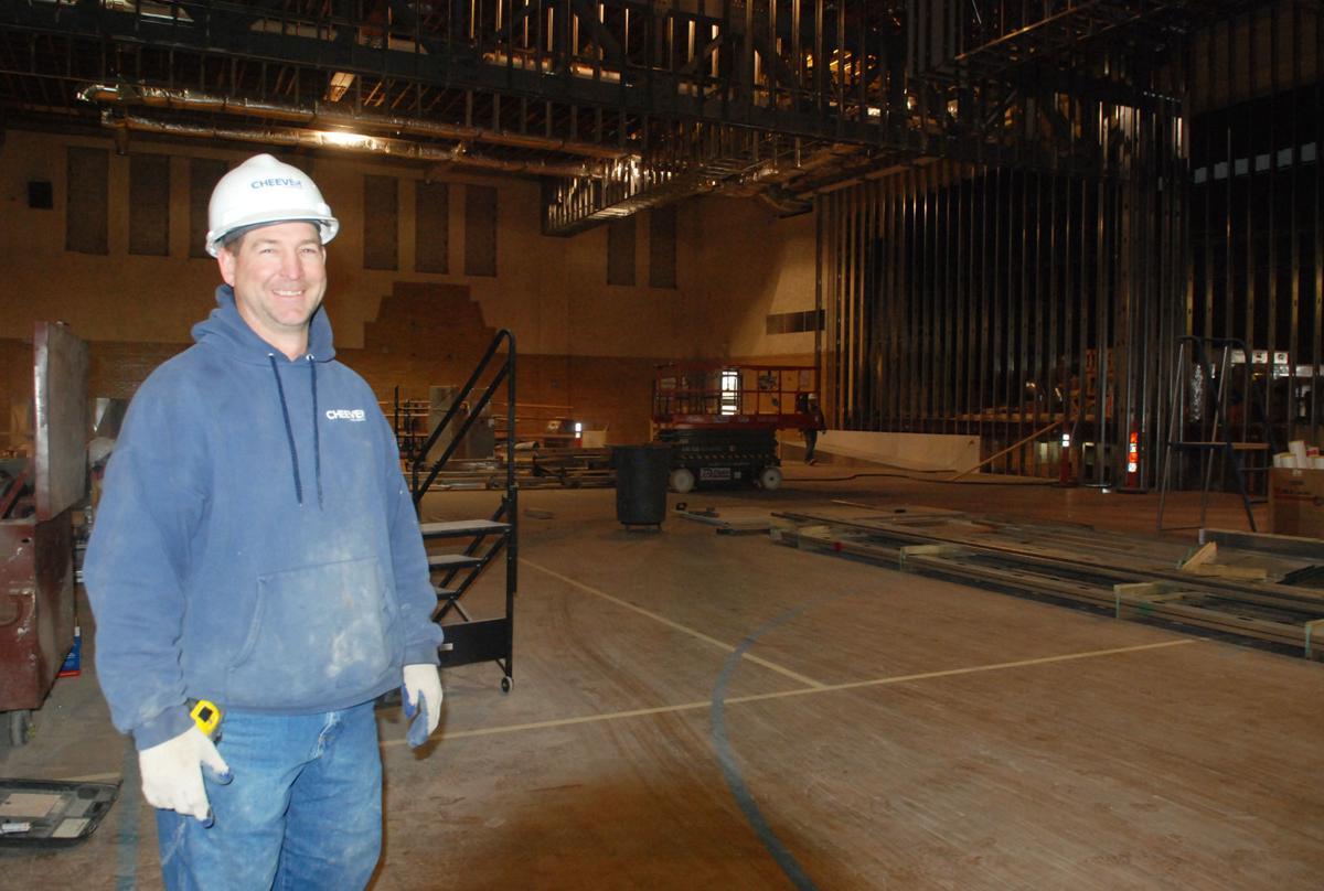 Man standing inside Fremont City Auditorium