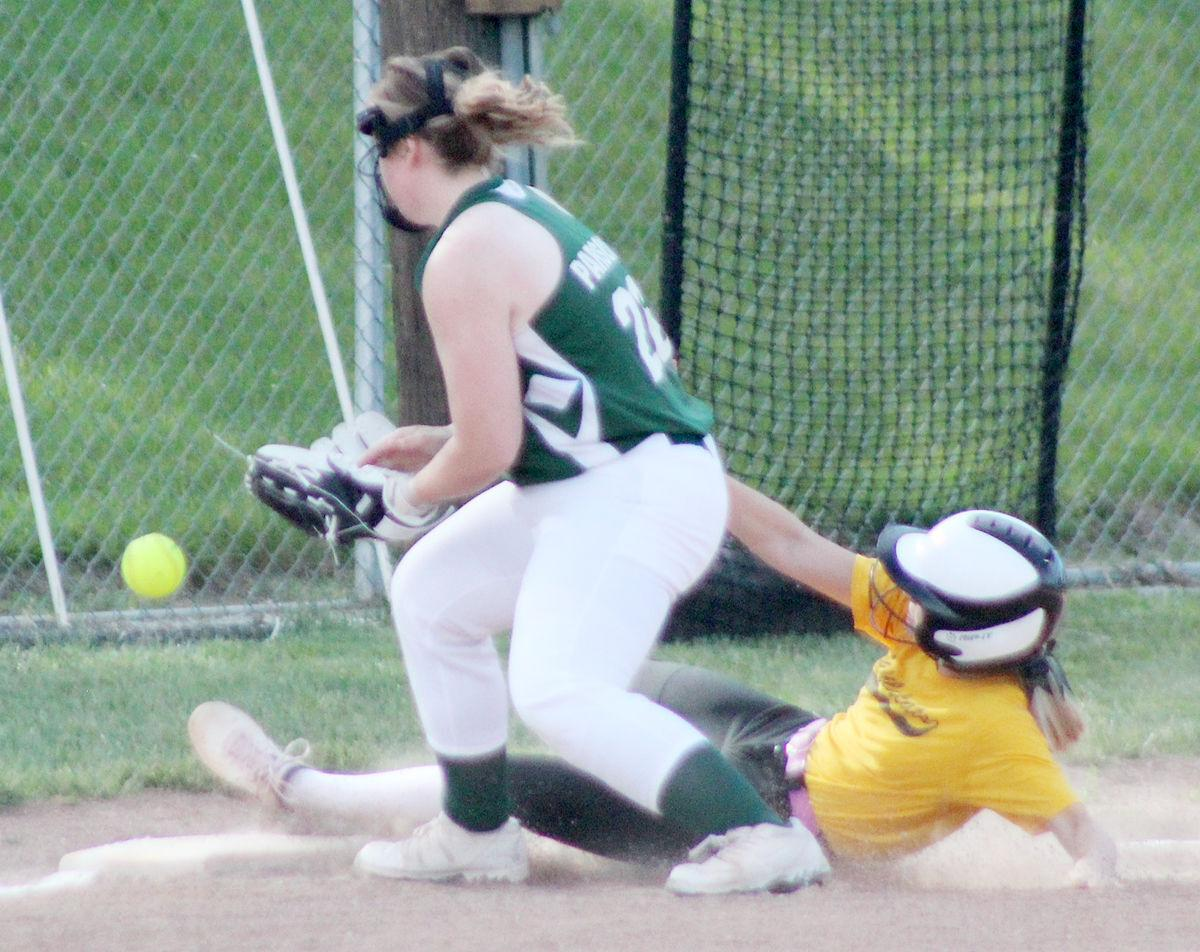 Ella Aaberg safe at third base in first inning