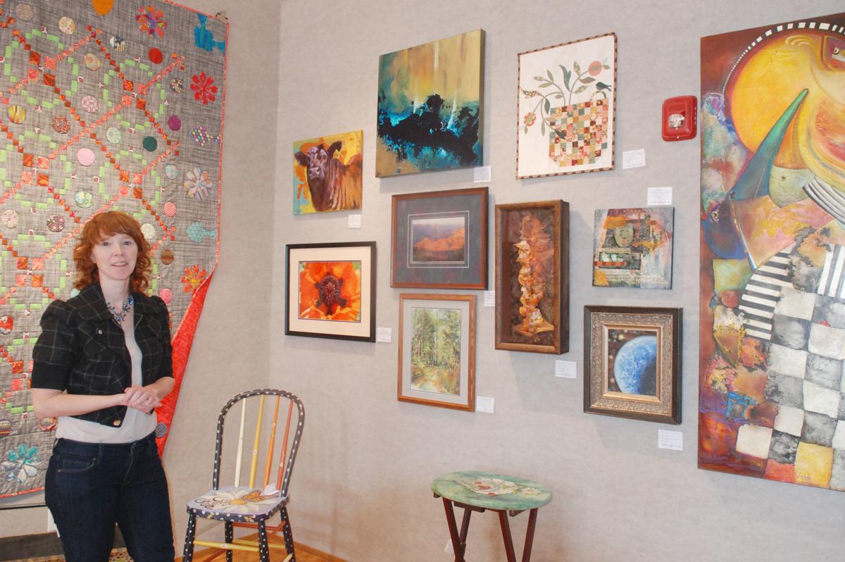 Angie near art in new Art Emporium
