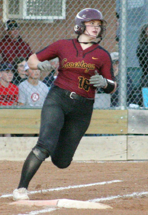 Becca Simpson rounds first base