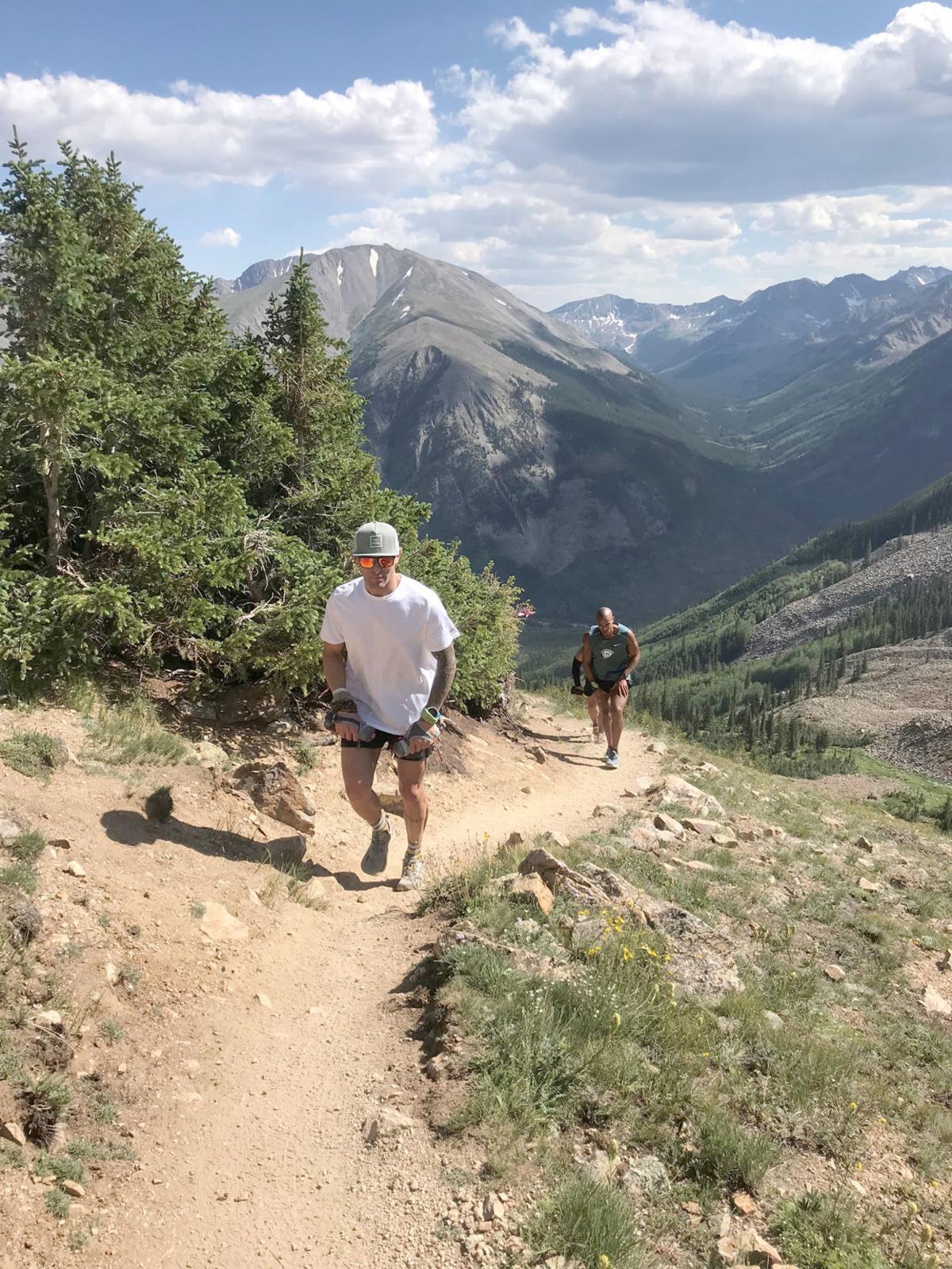 Running man in mountains