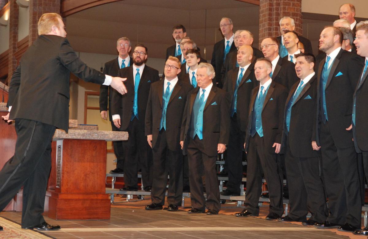 Man directs Pathfinder Chorus