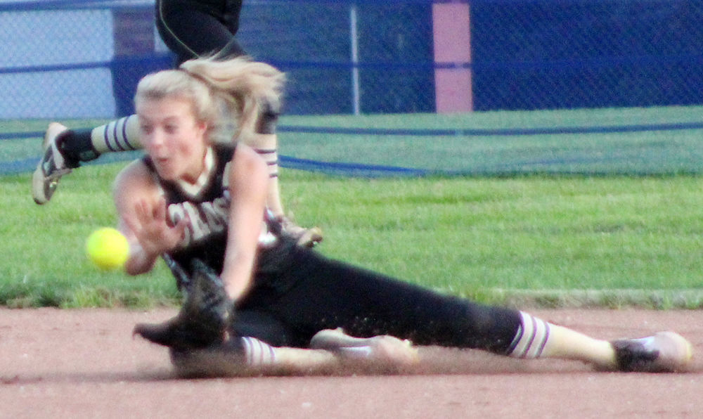 Grace Cave makes diving catch in center