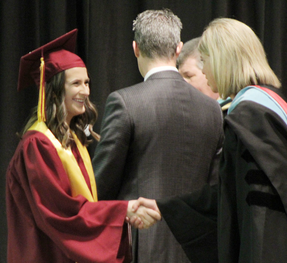 Sierra Dragoo shakes hands with Beth Johnsen
