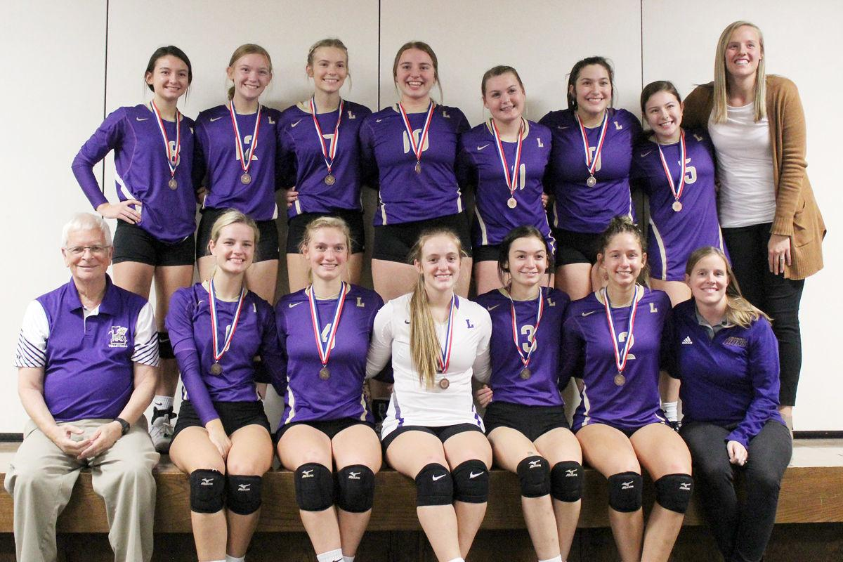 Volleyball team and coaches with medals