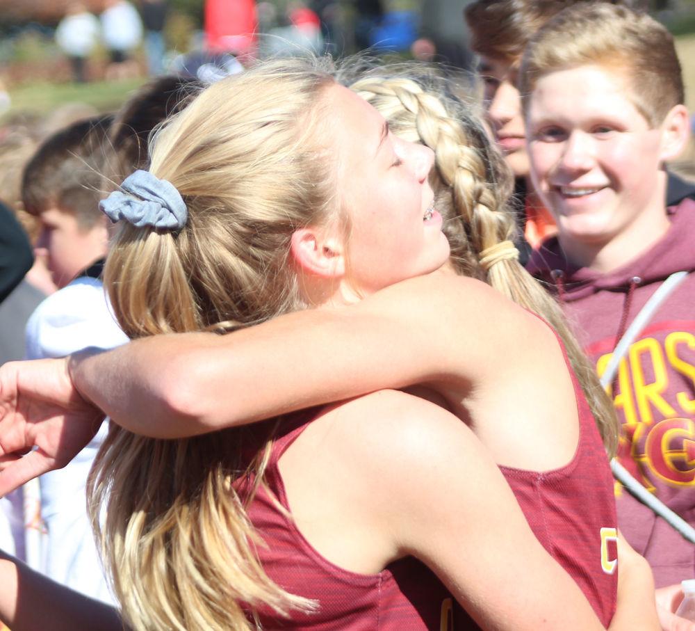 Danie Parriott and Bella Hogue hug after race