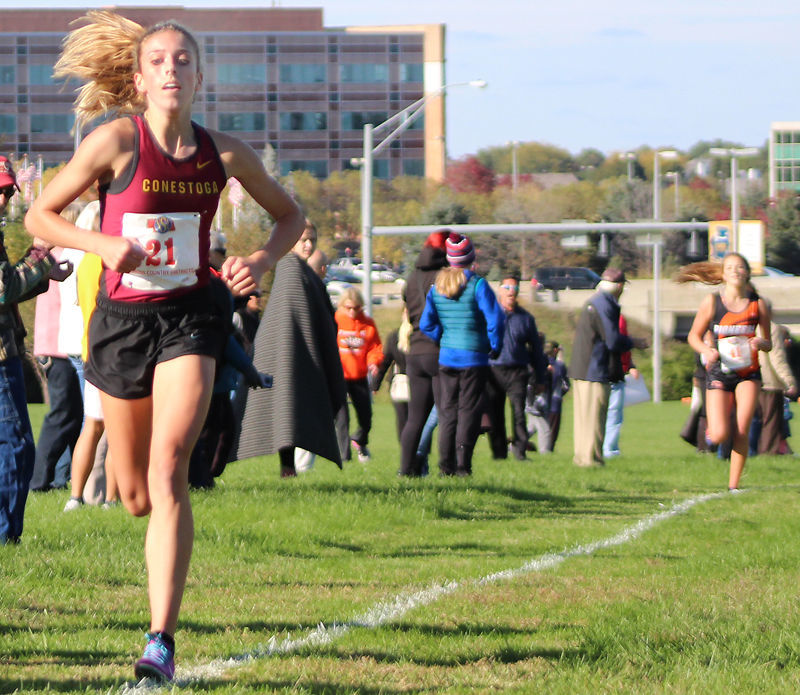 Bella Hogue at finish line of district race