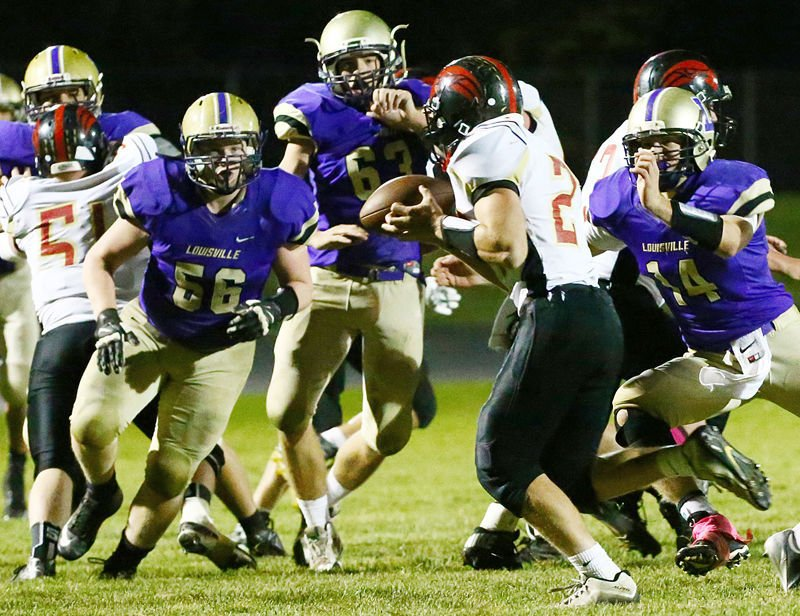 Louisville stops Johnson County Central in backfield