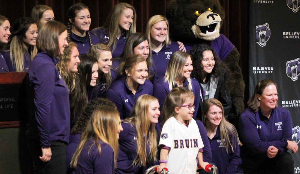 Softball team and Abigail Harvey