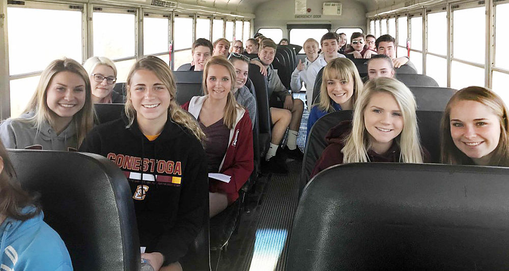 Students leaving on bus for Murray
