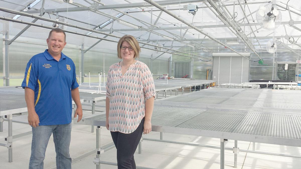 Educators inside greenhouse