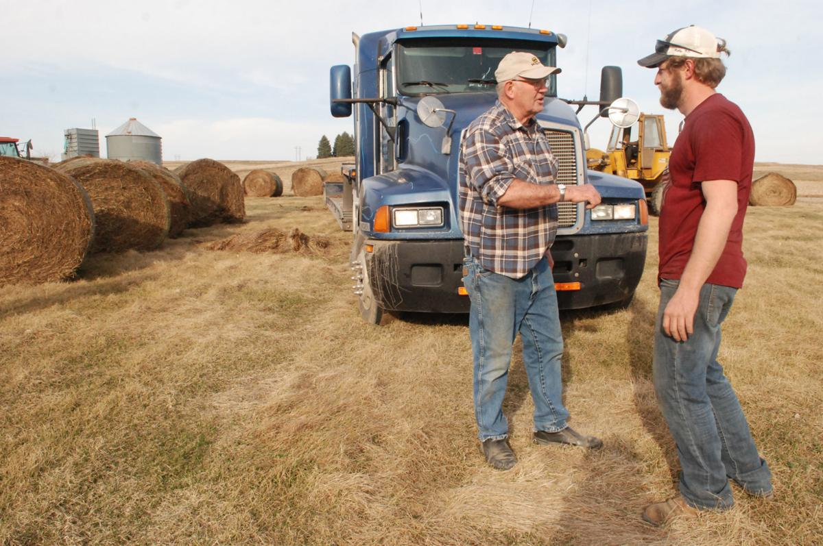 Farmer talking with truck driver