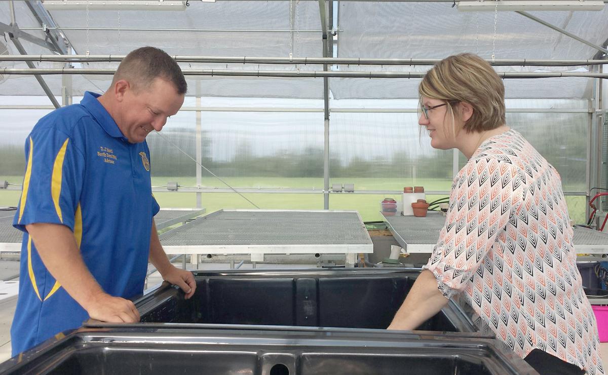 Educators looking at tubs