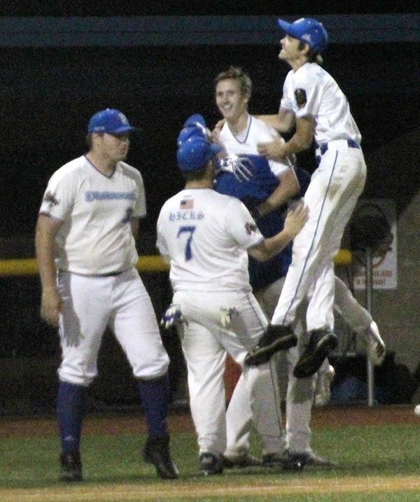 Teammates hug Connor Pohlmeier after winning hit