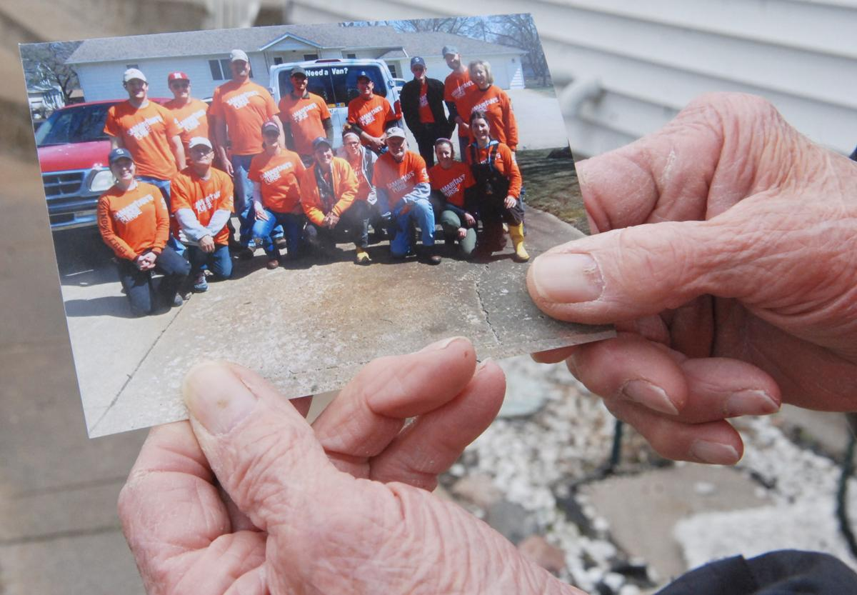 North Bend man holds photos of Samaritan's Purse volunteers