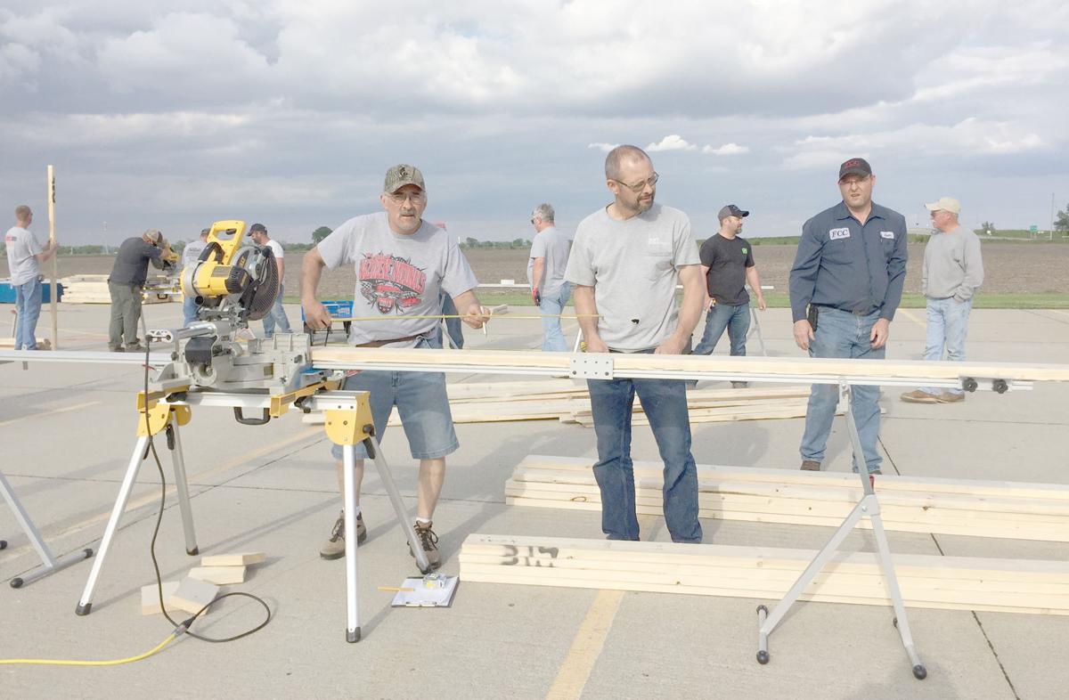 Habitat home build men with equipment