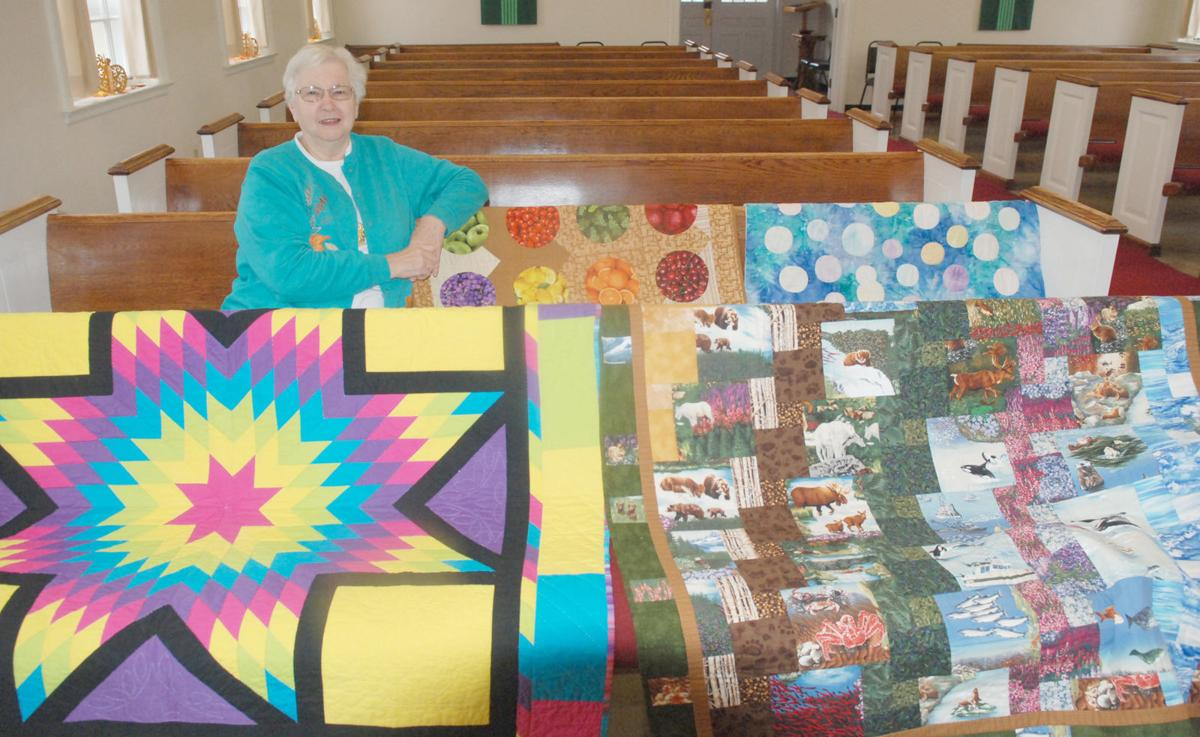 Quilter with quilts in church