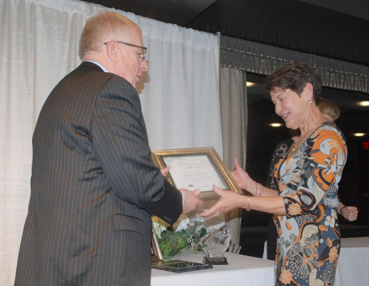 Terry McClain presenting certificate to Sheila Monke
