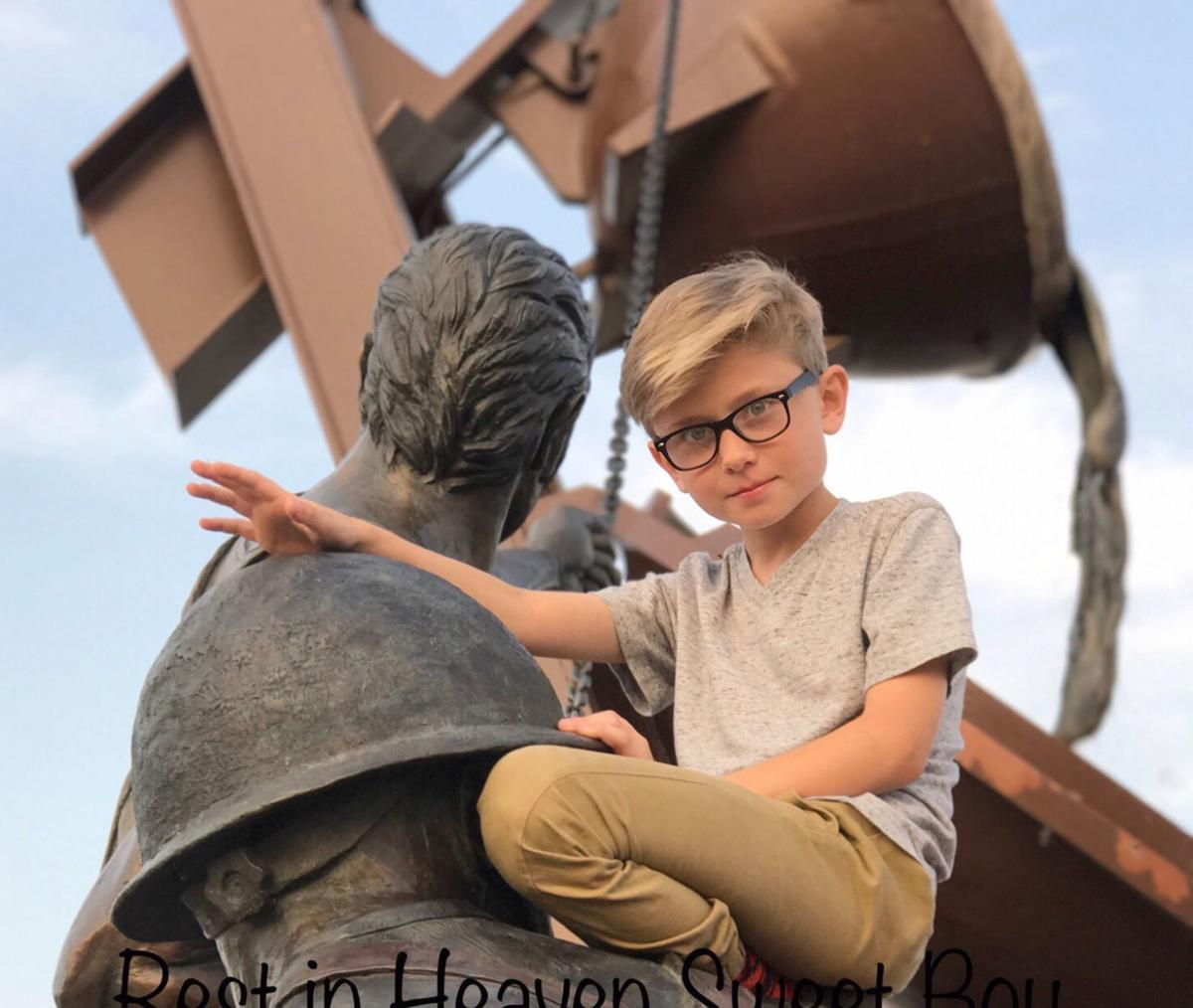 Thankful mom boy at statue