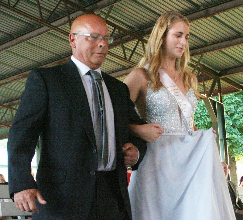 Sophia Svanda and Carey Svanda walk to stage