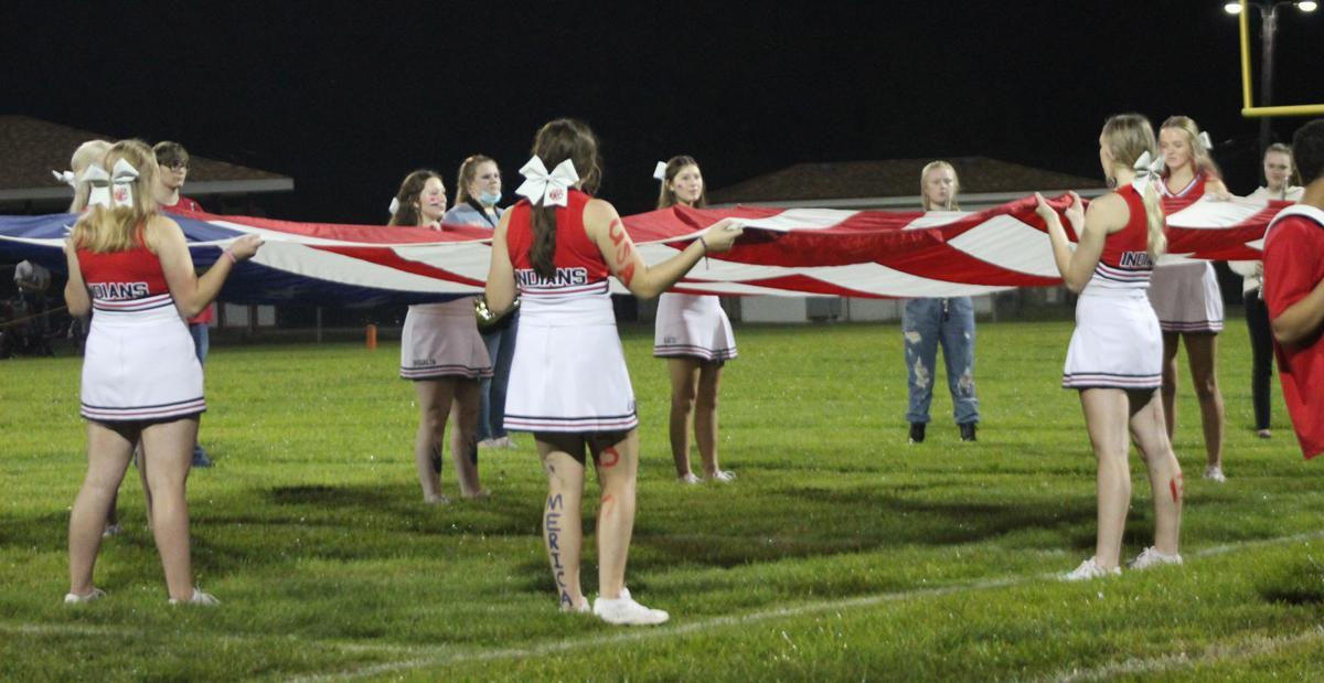 Weeping Water cheerleaders with flag photo 1